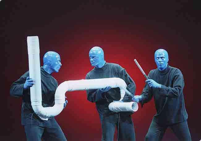 Blue Man playing the Drum-Bone